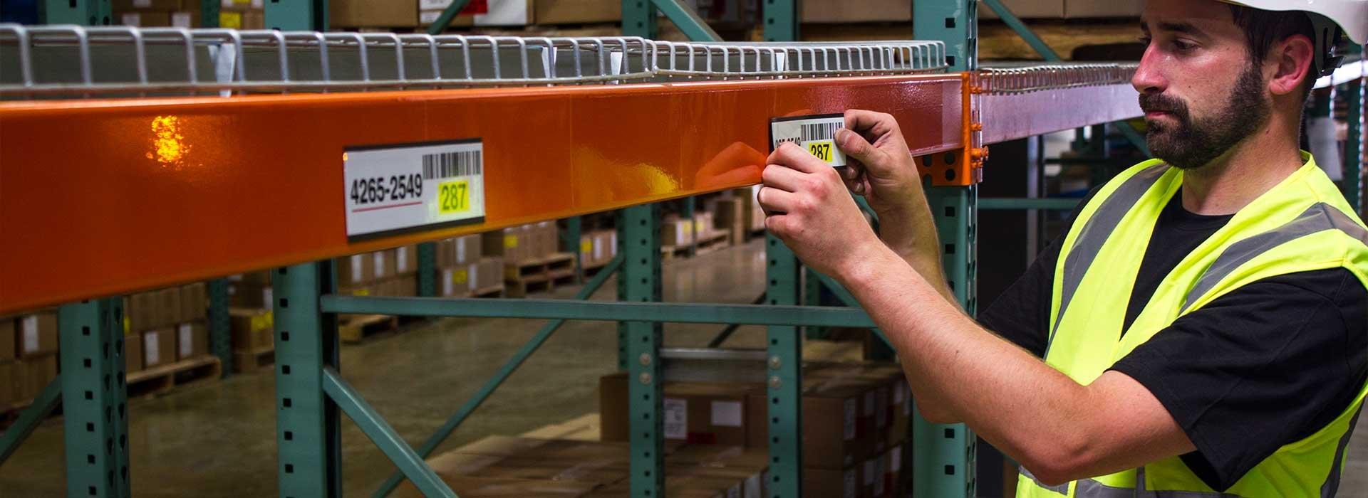 applying_label_to_warehouse_racking