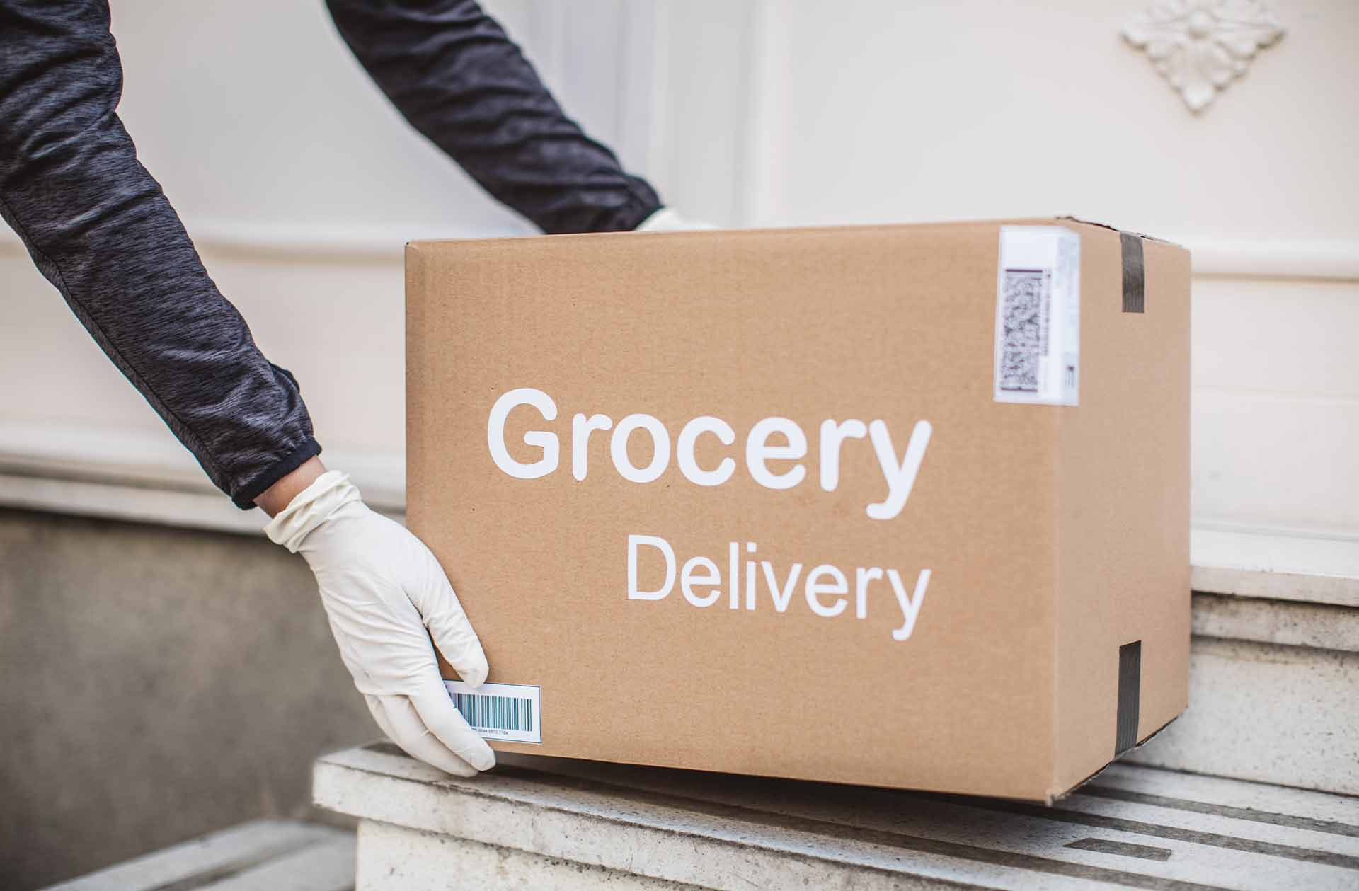 grocery_delivery_box_being_placed_on_steps