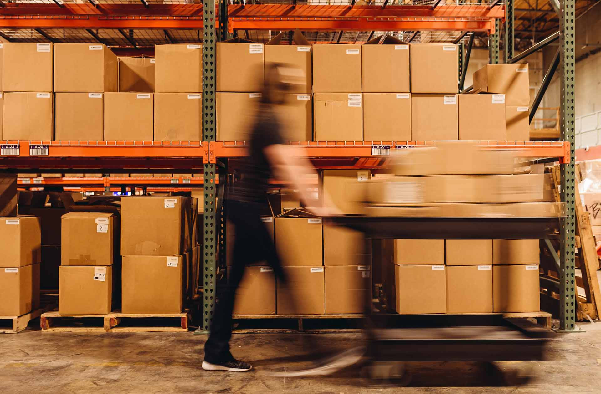 warehouse_worker_pushing_cart_quickly