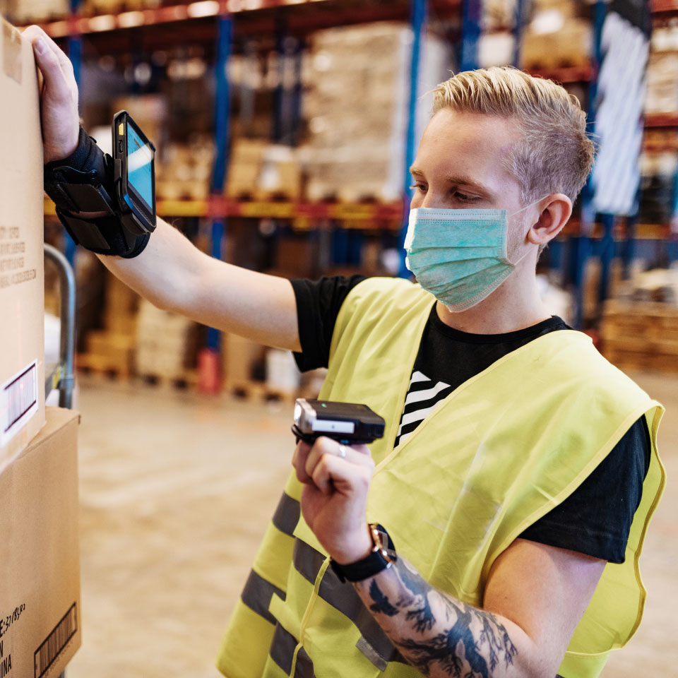 warehouse_worker_scanning_box_with_handheld_scanner