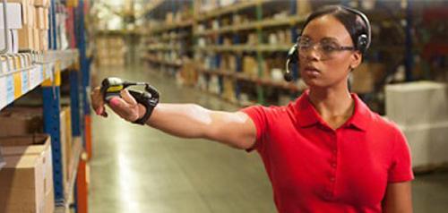 DC worker in Honeywell warehouse scanning barcode