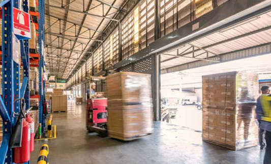 pallet jacks moving cargo in a warehouse