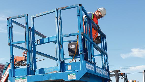 Construction worker in vertical lift